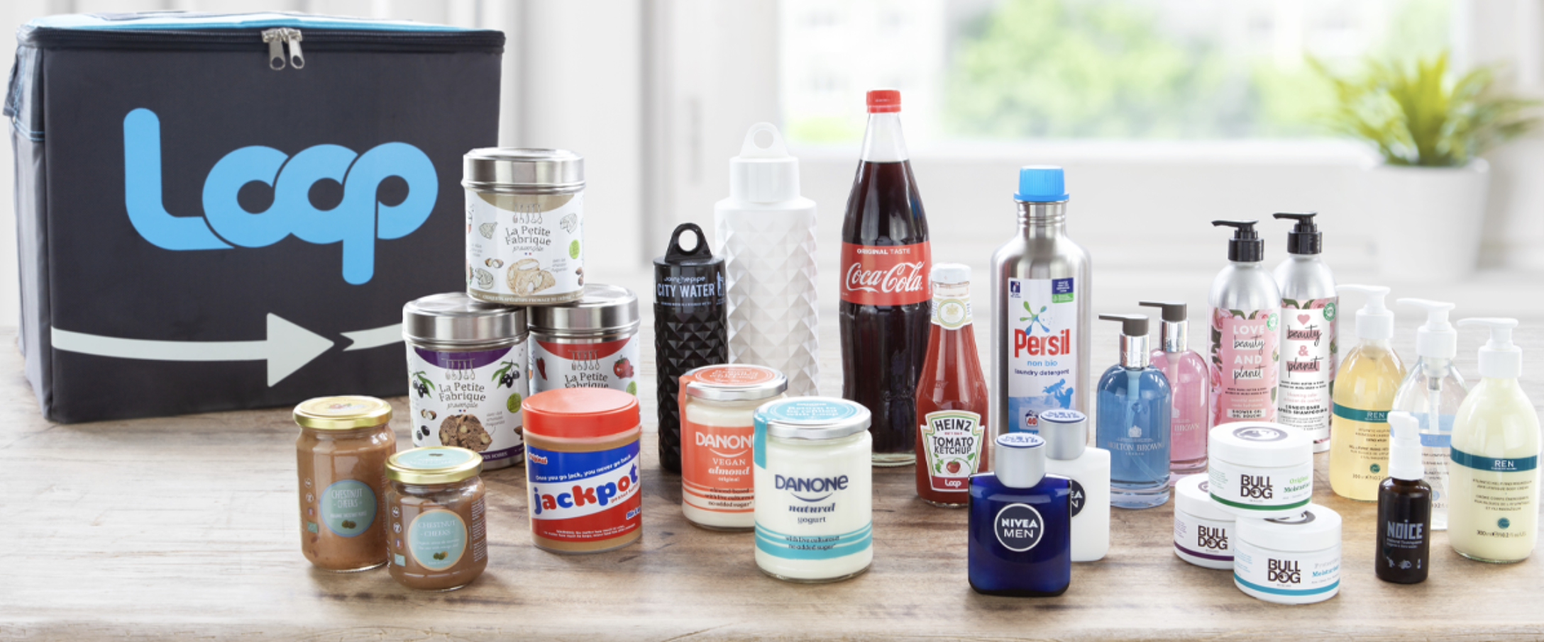 A variety of groceries and household products in reusable containers