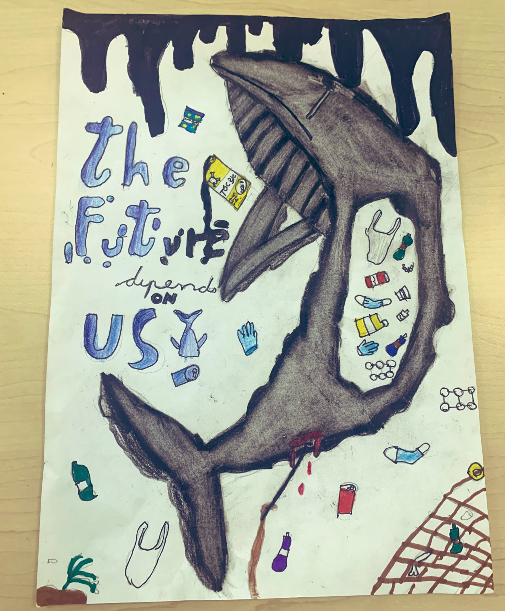 Poster drawn by a school pupil calling for better ocean protection. Features a whale with plastic in its stomach.