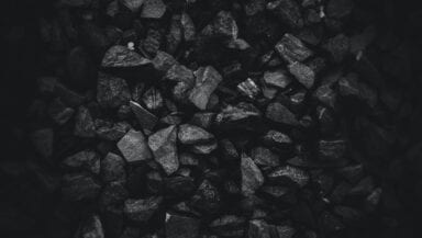 A pile of coal fills the frame