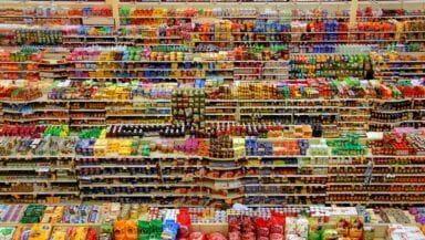 Aerial view of colourful products arranged on supermarket shelves
