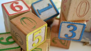 Colourful wooden blocks painted with letters and numbers