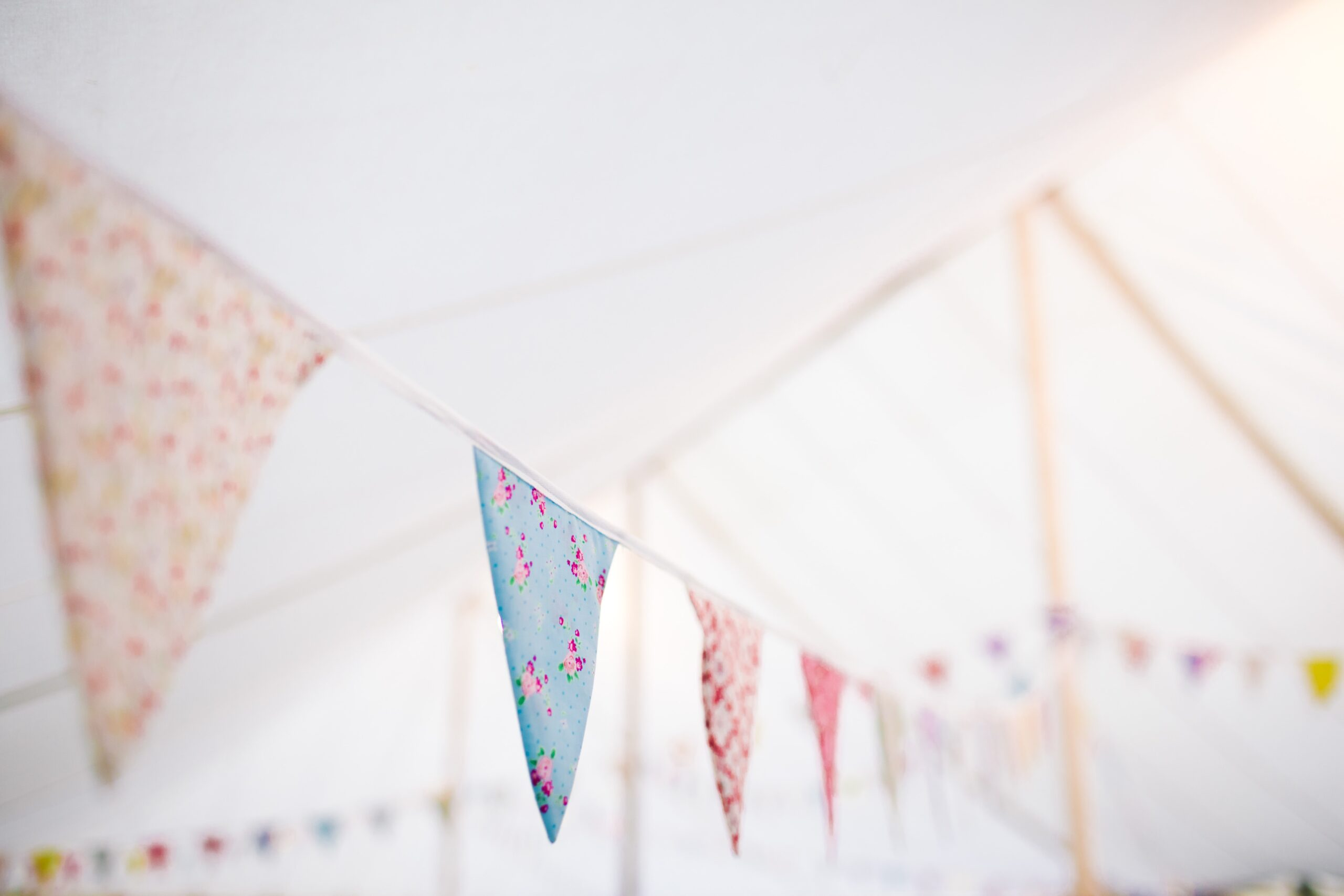 A string of home made bunting made from various colourful fabrics