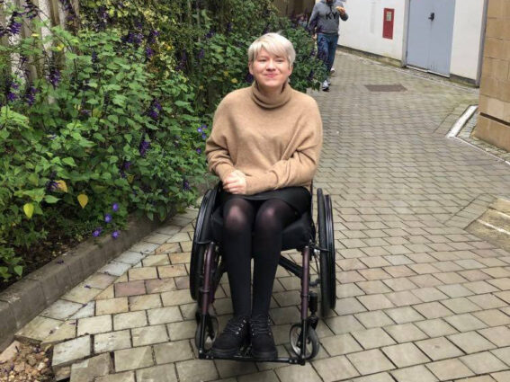 Melissa Parker outdoors in a wheelchair