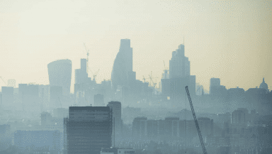 London skyline with skyscrapers shrouded in fog