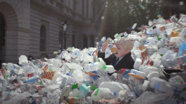 Still from animated film showing Boris Johnson being swept away by a wave of plastic waste