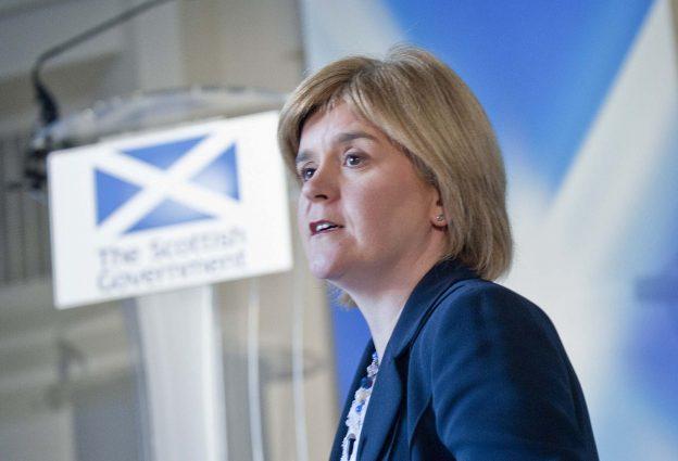 Nicola Sturgeon speaking from a podium