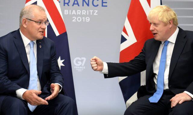 Boris Johnson and Scott Morrison fist bump